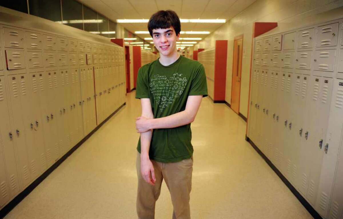Seventeen-year-old Will Sawin stands in the halls of Fairfield Warde High School Friday, May 20, 2011. The high school senior will graduate from Yale University with a double major in math and economics before finishing high school next month.