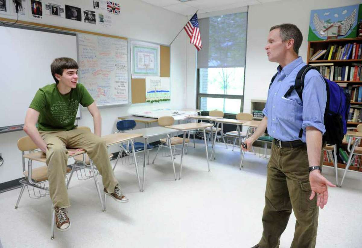Seventeen-year-old Will Sawin talks politics with Fairfield Warde teacher Stephen O'Brien Friday, May 20, 2011 after school. The high school senior will graduate from Yale University with a double major in math and economics before finishing high school next month.