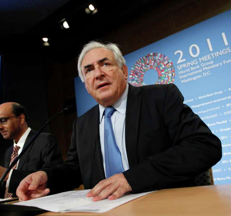 FILE - In this April 16, 2011 file photo, International Monetary Fund Managing Director Dominique Strauss-Kahn arrives for a news conference after the International Monetary Fund Committee met in Washington. The arrest and resignation of Dominique Strauss-Kahn, chief of the International Monetary Fund, has put the debt troubles in Europe back in the news. (AP Photo/J. Scott Applewhite, file) Photo: J. Scott Applewhite