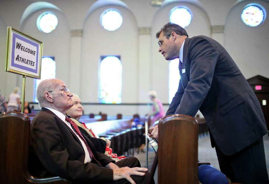 FOR METRO - Baptist Temple Church pastor Jorge Zayasbazan (right) talks with Dr. Ernest Gregory and his wife Valna Gregory before a service Sunday May 15, 2011.  (PHOTO BY EDWARD A. ORNELAS/eaornelas@express-news.net) Photo: EDWARD A. ORNELAS, Edward A. Ornelas/Express-News / SAN ANTONIO EXPRESS-NEWS (NFS)