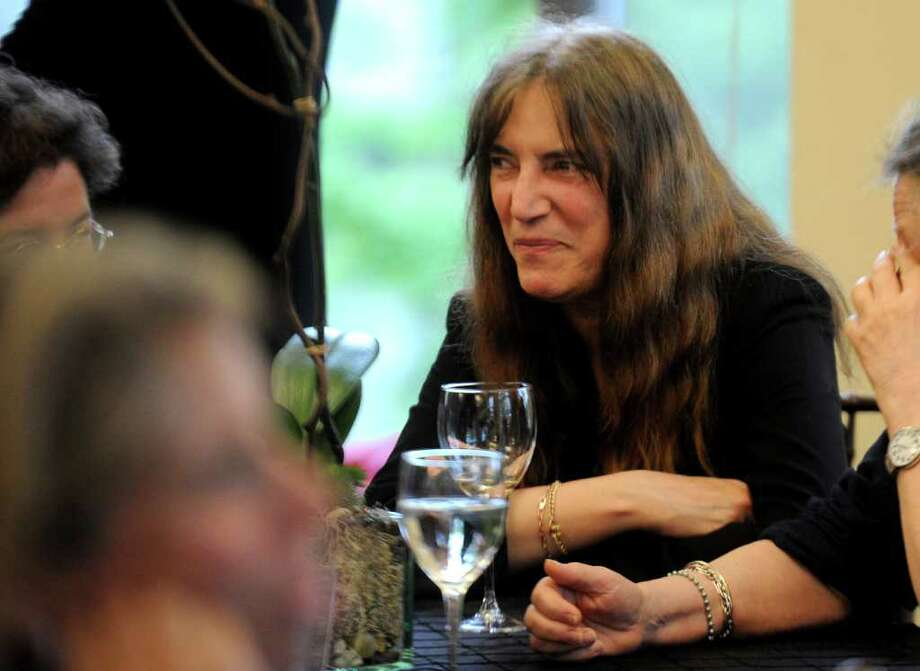 Patti Smith chats during a reception at the Westport Public Library on Thursday, May 19, 2011. Smith was given the 13th annual Westport Public Library award. Photo: Lindsay Niegelberg / Connecticut Post