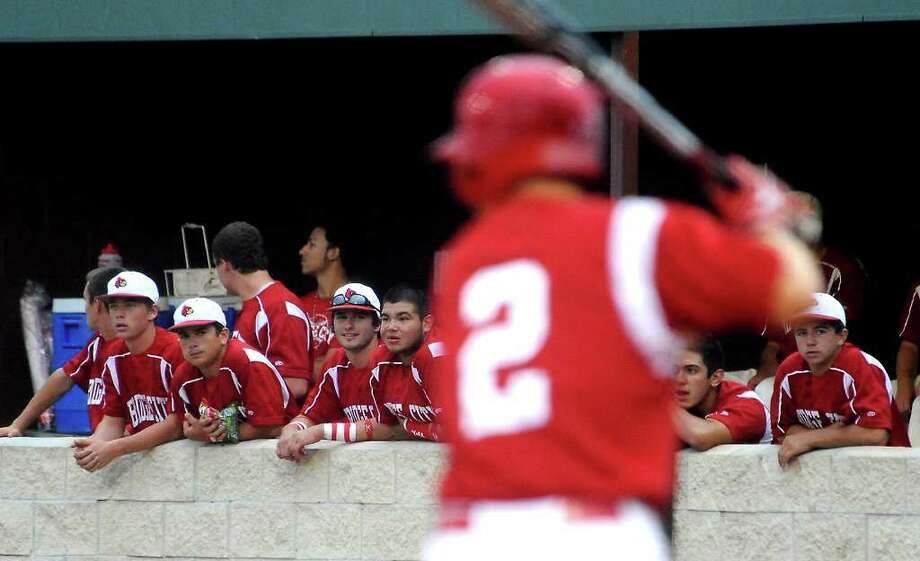 The Bridge City Cardinals watch as teammate Bryce Sampere' is up to bat against Giddings during the Class 3A regional quarterfinal play-off game at College Park High School in The Woodlands, Friday. Tammy McKinley/The Enterprise Photo: TAMMY MCKINLEY