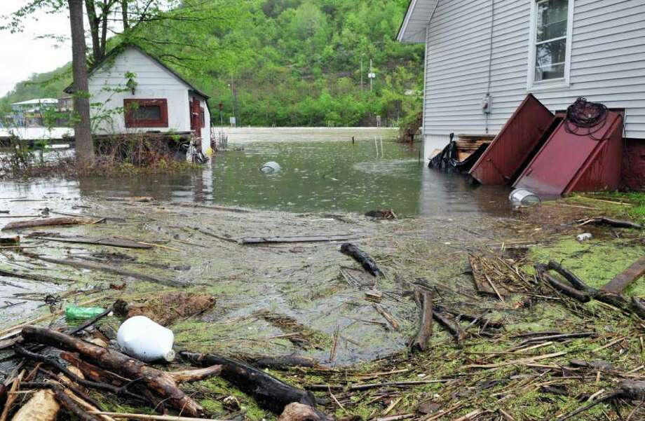 Flotsam fills the backyards of flooded homes on North Main Street in Whitehall on Friday, May 20, 2011.   (John Carl D'Annibale / Times Union) Photo: John Carl D'Annibale / 00013219A