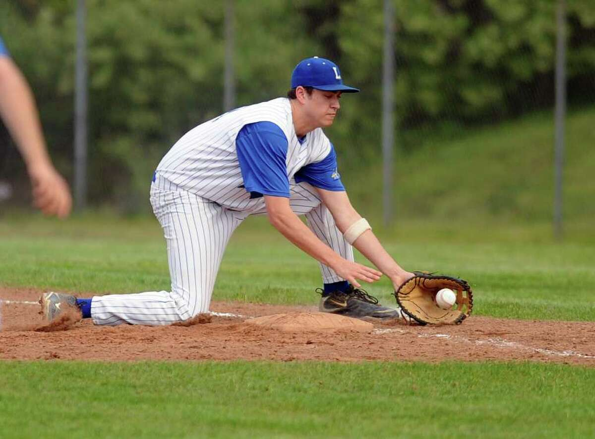 Ludlowe's Luke Clifford fields a foul ball during Friday's game at Fairfield Ludlowe High School on May 20, 2011.