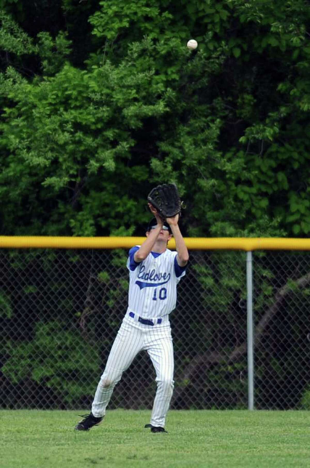 Ludlowe's Alex Wright makes a catch in the outfield during Friday's game against Ridgefield at Fairfield Ludlowe High School on May 20, 2011.