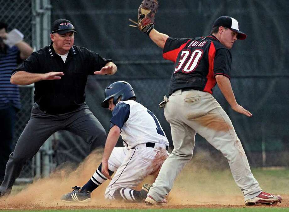 Boerne Champion's Zach Long beats a throw to third base under the glove of Lake Travis' David Hulls during the Chargers' thrilling Class 4A third-round victory.  TOM REEL/treel@express-news.net Photo: TOM REEL, Express-News / © 2011 San Antonio Express-News