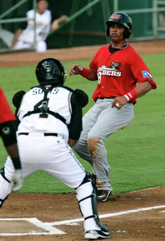 Frisco Roughriders' Leonys Martin (right) gets caught at home plate by Missions' catcher Ali Solis in the first inning at Wolff Stadium on Friday, May 20, 2011. Kin Man Hui/kmhui@express-news.net / San Antonio Express-News