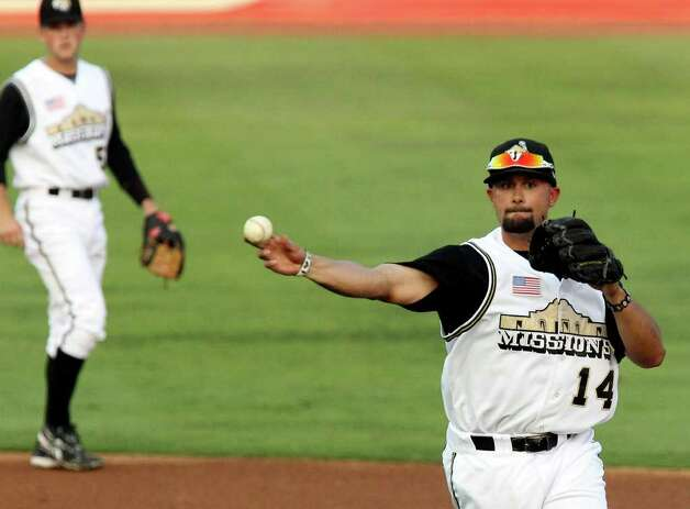 Missions second baseman Vince Belnome (14) fires a throw to first base for an out in the second inning against the Frisco Roughriders at Wolff Stadium on Friday, May 20, 2011. Belnome was one of eight Missions players selected for the 75th Texas League All-Star Game. Kin Man Hui/kmhui@express-news.net / San Antonio Express-News