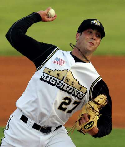 Missions' starting pitcher Anthony Bass winds up a throw against the Frisco Roughriders at Wolff Stadium on Friday, May 20, 2011. Bass was one of four Missions pitchers and eight Missions players selected for the 75th Texas League All-Star Game. Kin Man Hui/kmhui@express-news.net / San Antonio Express-News