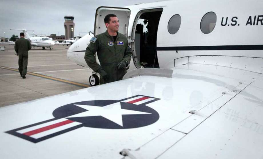First Lt. Ryan McGuire prepares for a flight on a T-1 trainer aircraft. He's the first Air Force amputee to win his wings. Photo: BOB OWEN, Bob Owen/Express-News / rowen@express-news.net
