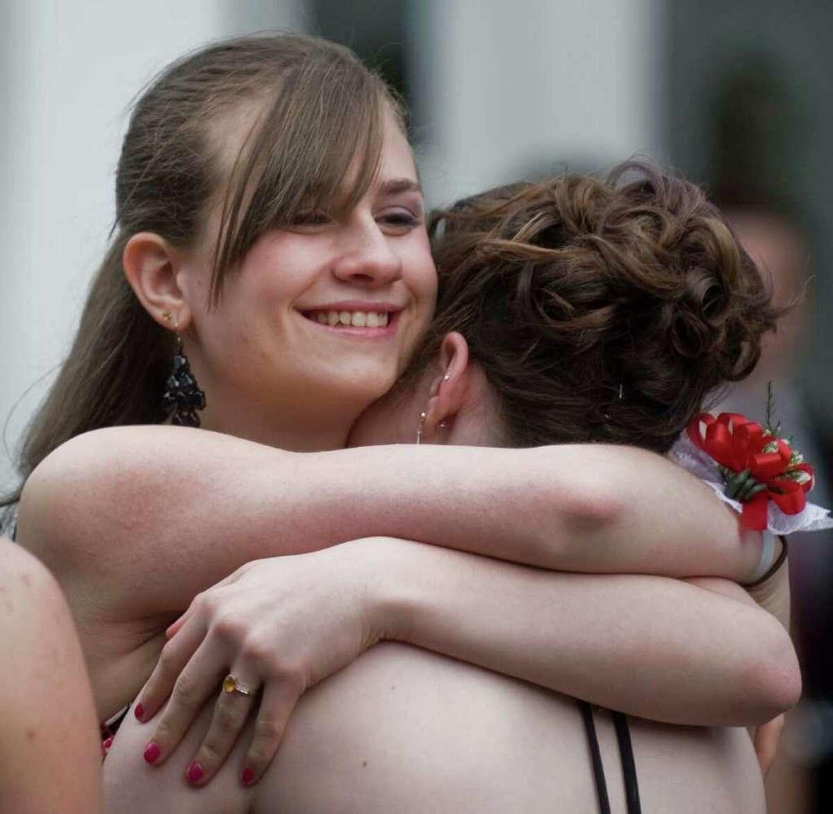 Abbott Tech junior Kyra Sterzinger receives a hug at the senior prom held at the Fox Hill Inn in Brookfield. Friday, May 20, 2011