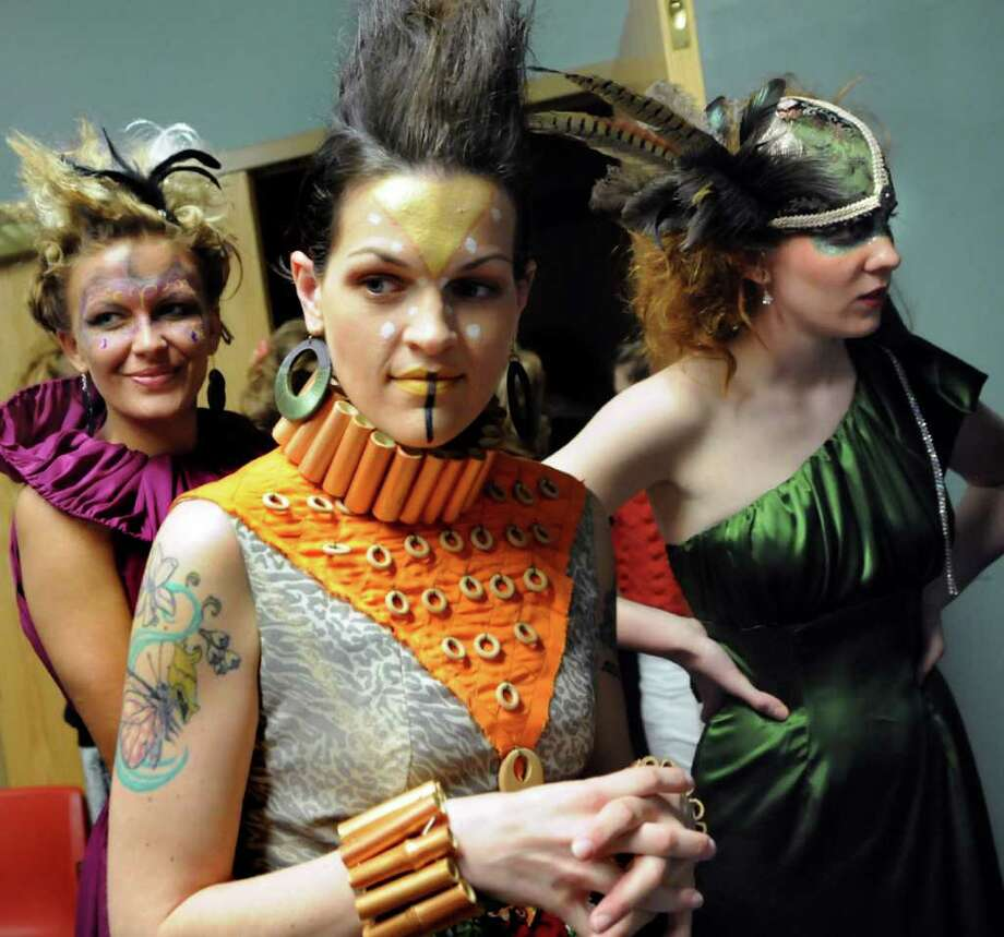Stephanie Dugan of Rensselaer, center, joins other models backstage as they prepare to show Jenn Dugan's Masquerade Collection during the Electric City Couture fashion show on Friday, May 20, 2011, at Proctors in Schenectady, N.Y. (Cindy Schultz / Times Union) Photo: Cindy Schultz