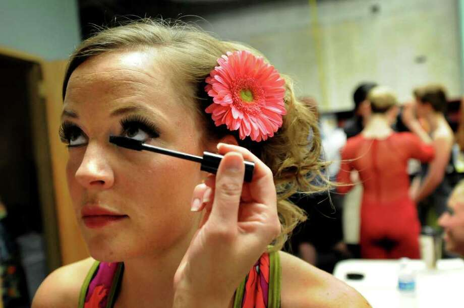 Model Carrie Barown of Albany gets her eyelashes touched up backstage at the Electric City Couture fashion show on Friday, May 20, 2011, at Proctors in Schenectady, N.Y. (Cindy Schultz / Times Union) Photo: Cindy Schultz