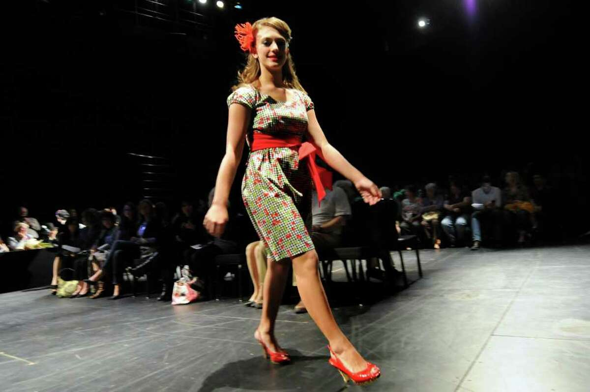A model wears a dress from the collection of Lorraine Murphy, of First Impressions Pinup Makeovers, during the Electric City Courture fashion show on Friday, May 20, 2011, at Proctors in Schenectady, N.Y. (Cindy Schultz / Times Union)