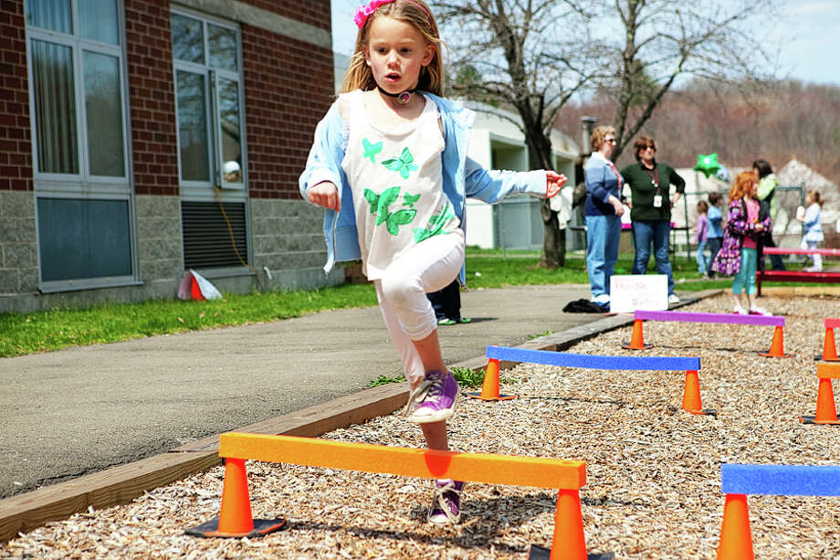 First-grader Payton Koch jumps hurdles. Photo: Contributed Photo / Mariola Camacho Photography