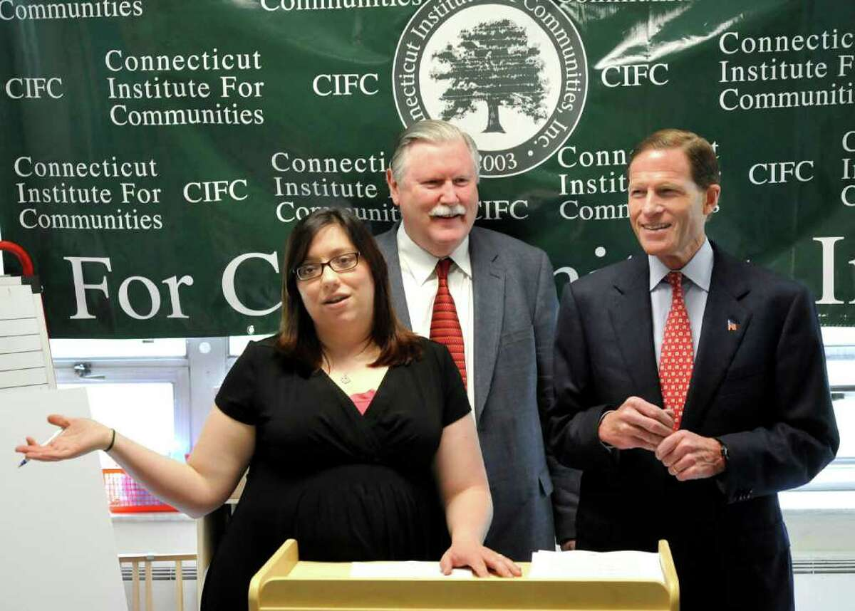 Monica Bevilacqua of Head Start in Danbury, Conn.introduces James Maloney, president and CEO of the Head Start of Northern Fairfield County program, left, and U.S. Sen. Richard Blumenthal.
