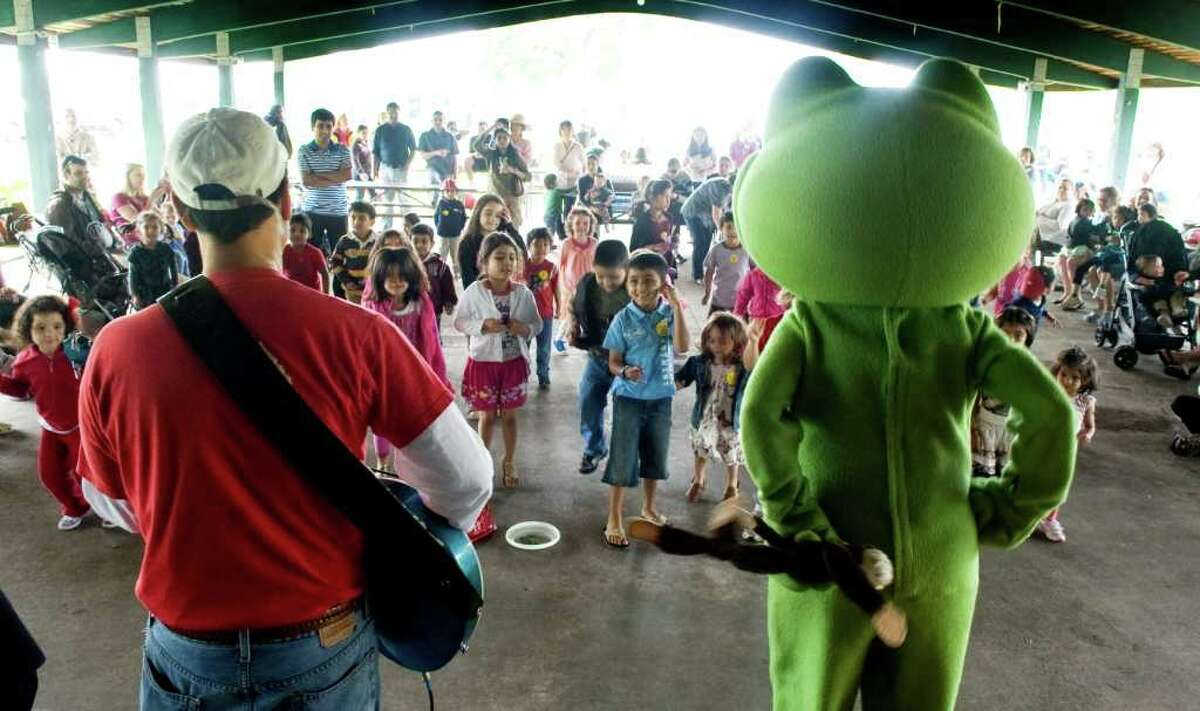 Children enjoy a performance by The Bossy Frog during the 4th Annual Early Childhood Fair at Cove Island Park in Stamford, Conn. on Saturday May 21, 2011.