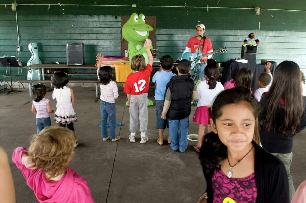 Children enjoy a performance by