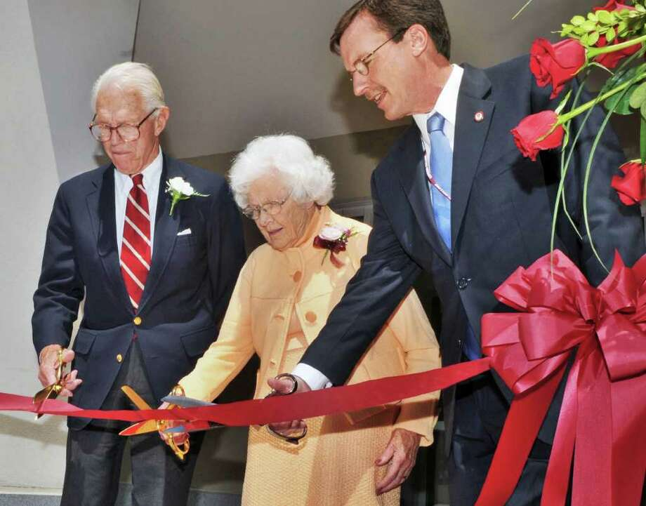 John S. Wold,left, Class of '38, his wife Jne and and Union College President Stephen C. Ainlay cut a ribbon opening Union's new  Peter Irving Wold Center, a $22 million, three-story, 35,000-square-foot building housing interdisciplinary research facilities, classroom space and an advanced computing lab Saturday afternoon May 21, 2011.  (John Carl D'Annibale / Times Union) Photo: John Carl D'Annibale / 00013236A