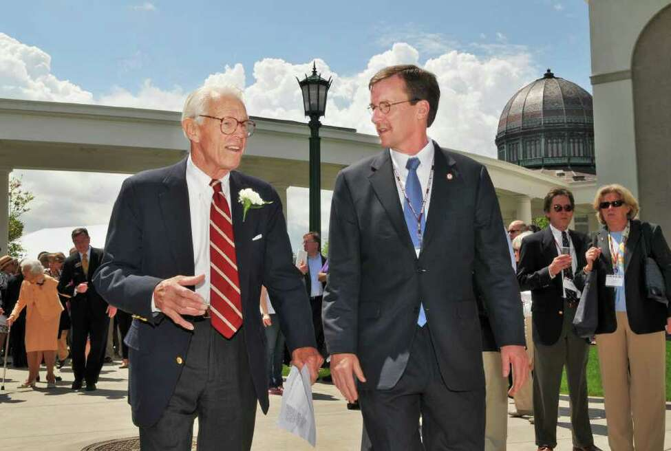 John S. Wold, left, Class of '38, and Union College President Stephen C. Ainlay make their way across campus to a ribbon cutting for Union's new Peter Irving Wold Center, a $22 million, three-story, 35,000-square-foot building housing interdisciplinary research facilities, classroom space and an advanced computing lab Saturday afternoon May 21, 2011. (John Carl D'Annibale / Times Union)