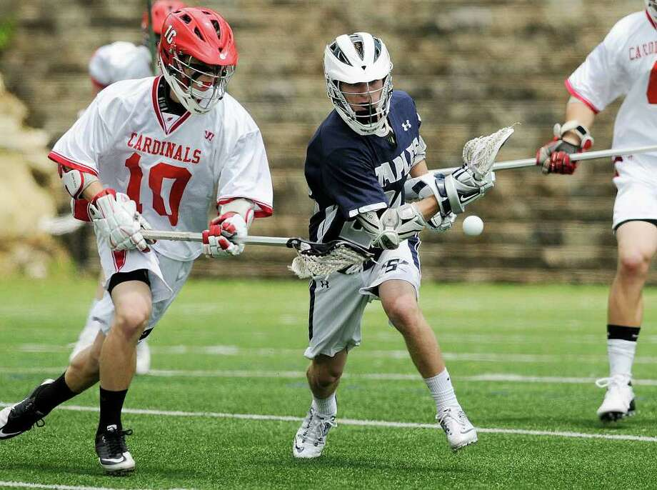 Greenwich #10 Fritz Waine and Staples #22 Joey Zelkowitz vie for the ball as Greenwich High School hosts Staples High School in boys varsity lacrosse  in Greenwich, CT on Saturday May 21, 2011. Photo: Shelley Cryan / Shelley Cryan freelance; Greenwich Time freelance