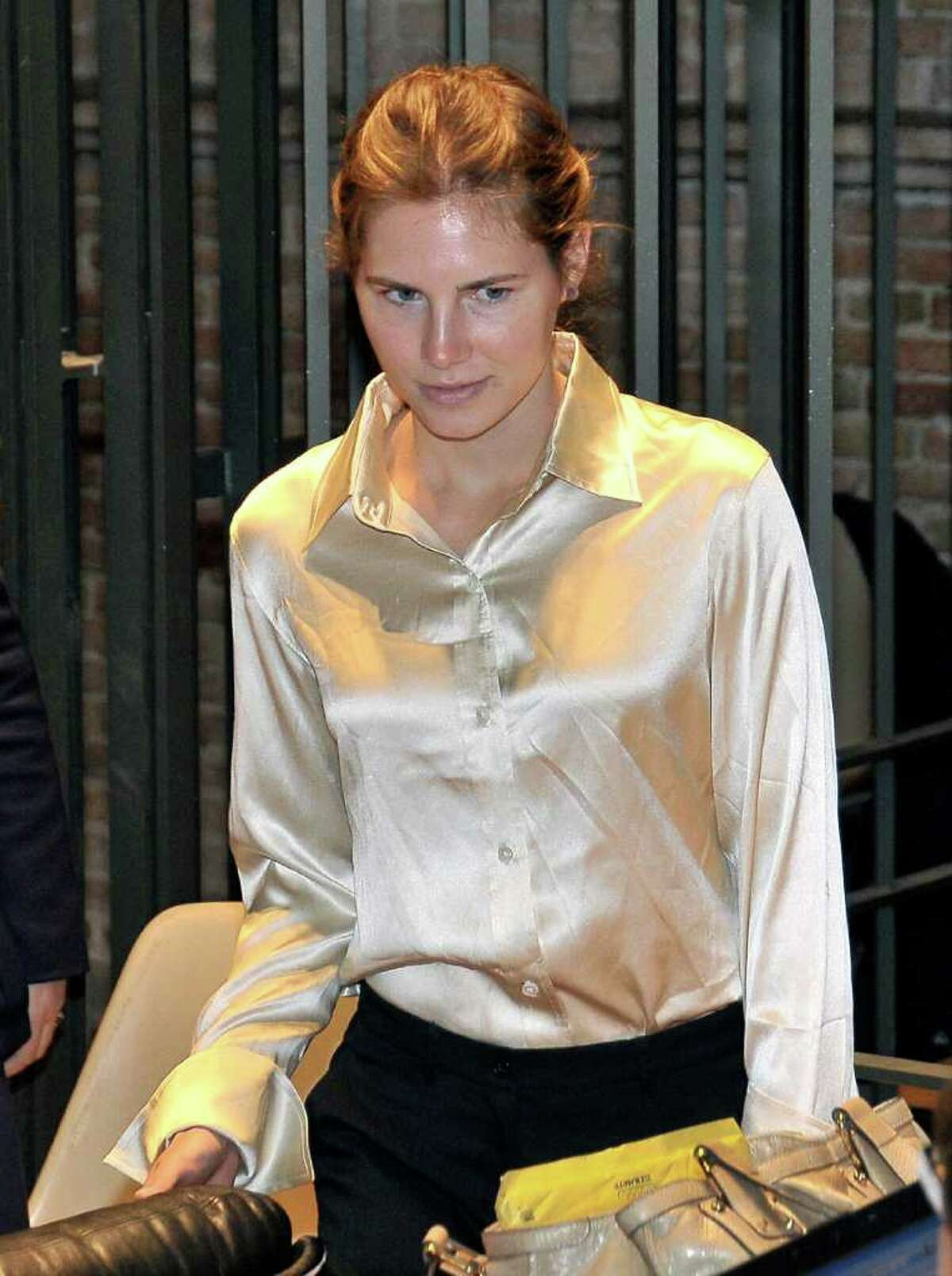 Amanda Knox arrives at the Perugia court, Italy, Saturday, May 21, 2011. A tearful Amanda Knox said Saturday that being in prison is