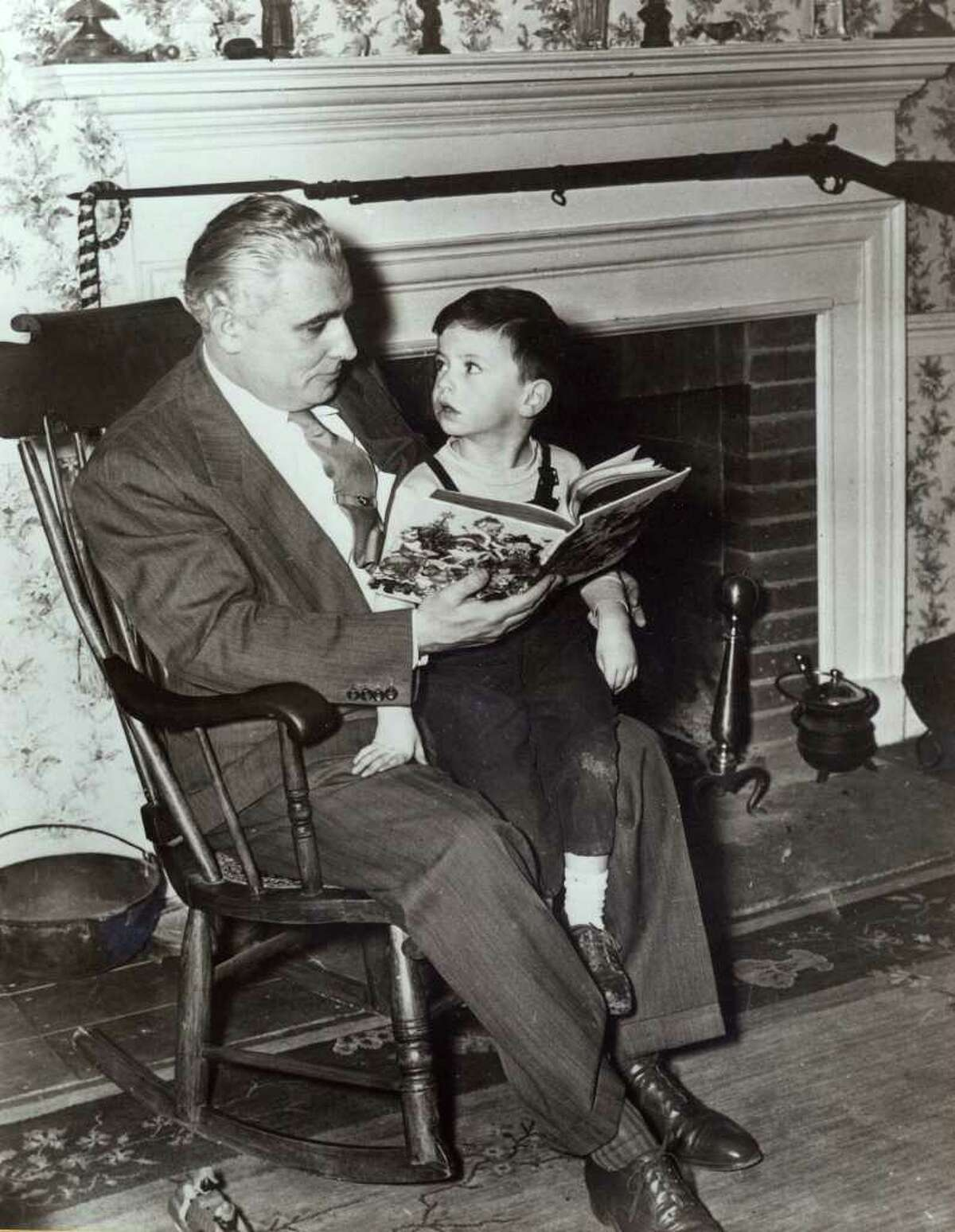 This photo released by the Dodd family shows former U.S. Sen Thomas Dodd, reading to his youngest son Christopher in Lebanon, Conn. Christopher would also go on to represent Connecticut in the U.S. Senate. (AP Photo/Dodd Family)
