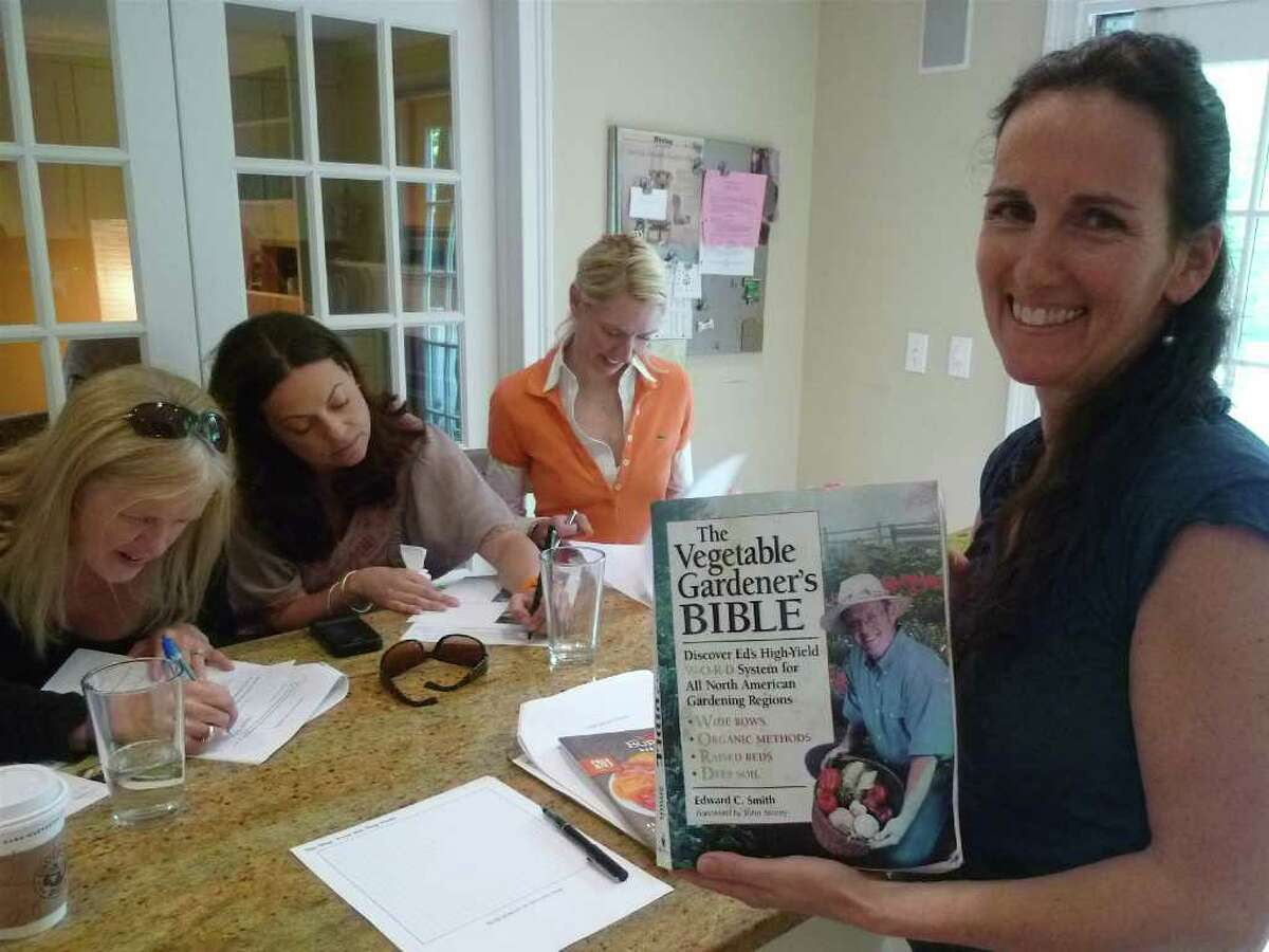 """Heather Carey, leading a Kitchen Garden Workshop, swears by """"The Vegetable Gardener's Bible"""" by Edward C. Smith as one of her inspirations."""