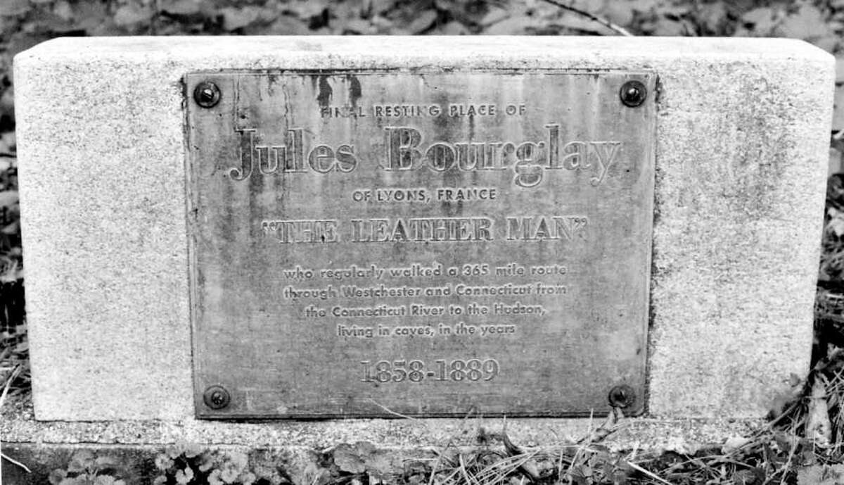 The headstone marking the gravesite of the 19th-century wanderer known as the Leatherman, whose identity is a mystery but who some believed was named Jules Bourglay, is located in Ossining, N.Y.