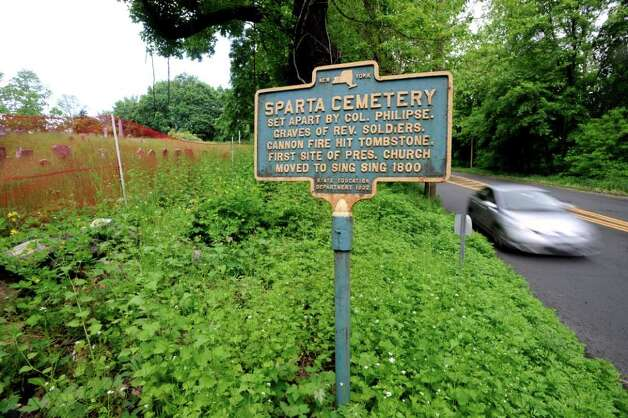 Sparta Cemetery in Ossining, N.Y., Thursday, May 19, 2011.  A person known as The Leather Man, a wanderer who dressed in a leather outfit and lived from 1858-1889, is thought to be buried in the cemetery.  At right is the Albany Post Road, also known as Route 9. Photo: Bob Luckey / Greenwich Time