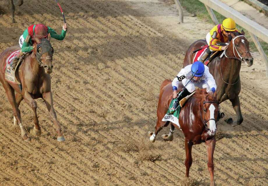 Shackleford (5) ridden by Jesus Castanon, moves to the finish line to win the 36th Preakness Stakes horse race at Pimlico Race Course, Saturday, May 21, 2011, in Baltimore. Animal Kingdom, left, ridden by John Velazquez, placed second and Astrology, right, took third. (AP Photo/Patrick Semansky) Photo: Patrick Semansky