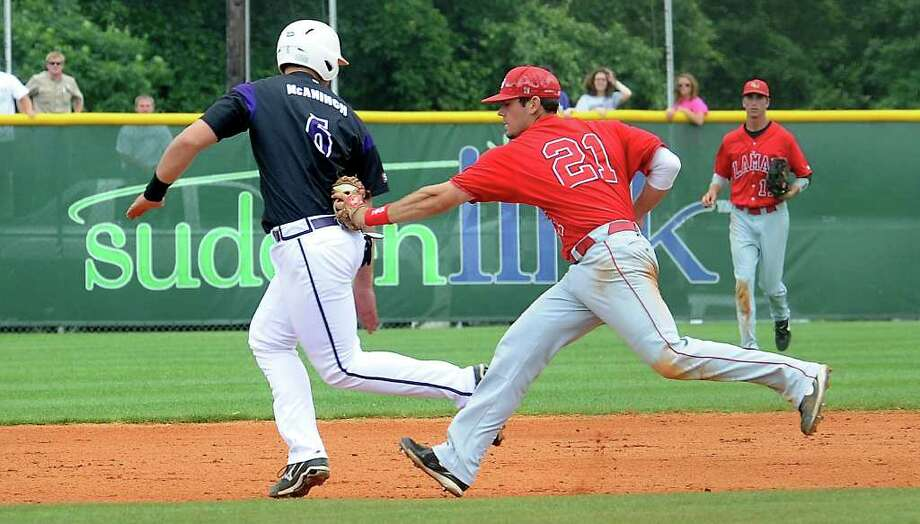 Lamar's Andy Mena chases down SFA's Justin McAnnich at the Jaycees Field in Nacogdoches, Saturday. Tammy McKinley/The Enterprise Photo: TAMMY MCKINLEY
