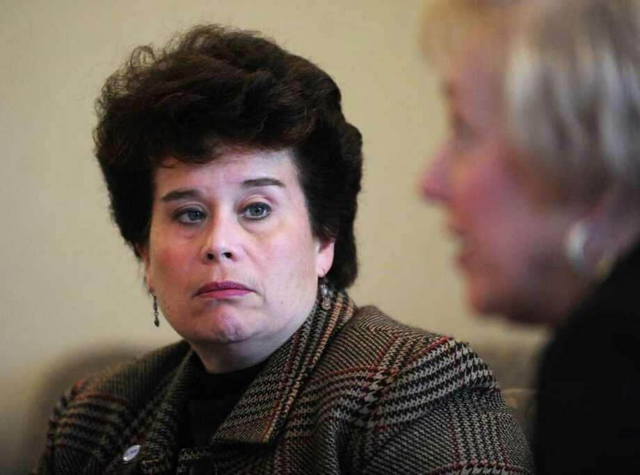 From left, Monica Rimai, Senior Vice Chancellor and Chief Operating Officer, listens to Nancy Zimpher, chancellor of SUNY, speak during an editorial board meeting at the Times Union in Colonie, NY on March 16, 2011. (Lori Van Buren / Times Union) Photo: Lori Van Buren