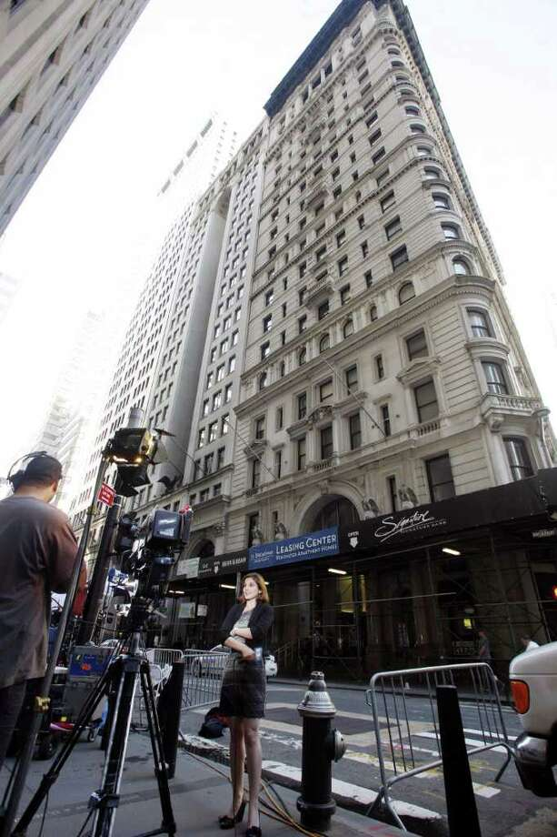 Reporters wait outside a building in downtown Manhattan where the former head of the International Monetary Fund Dominique Strauss-Kahn, who was granted bail, is staying under house arrest Saturday, May 21, 2011 on charges he tried to rape a hotel maid. (AP Photo/David Karp) Photo: David Karp