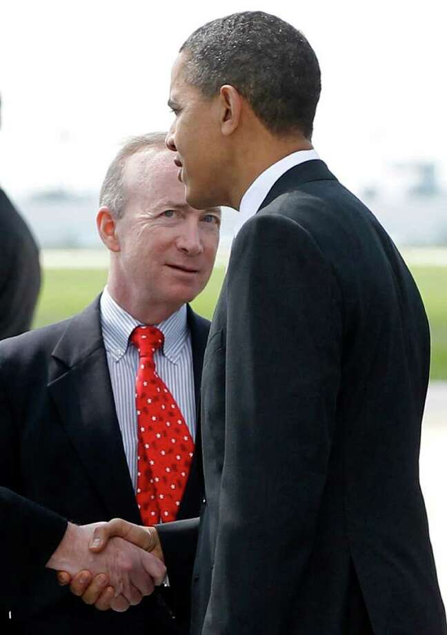 FILE - In this May 6, 2011, file photo Indiana Gov. Mitch Daniels greets President Barack Obama upon his arrival in Indianapolis, Ind. Tensions between tea partyers and more traditional Republicans are rising as influential GOP donors try to entice a more established candidate to jump into the 2012 presidential race. Influential GOP donors have sought to coax Daniels, former Florida Gov. Jeb Bush or New Jersey Gov. Chris Christie to run. (AP Photo/Charles Dharapak, File) Photo: Charles Dharapak