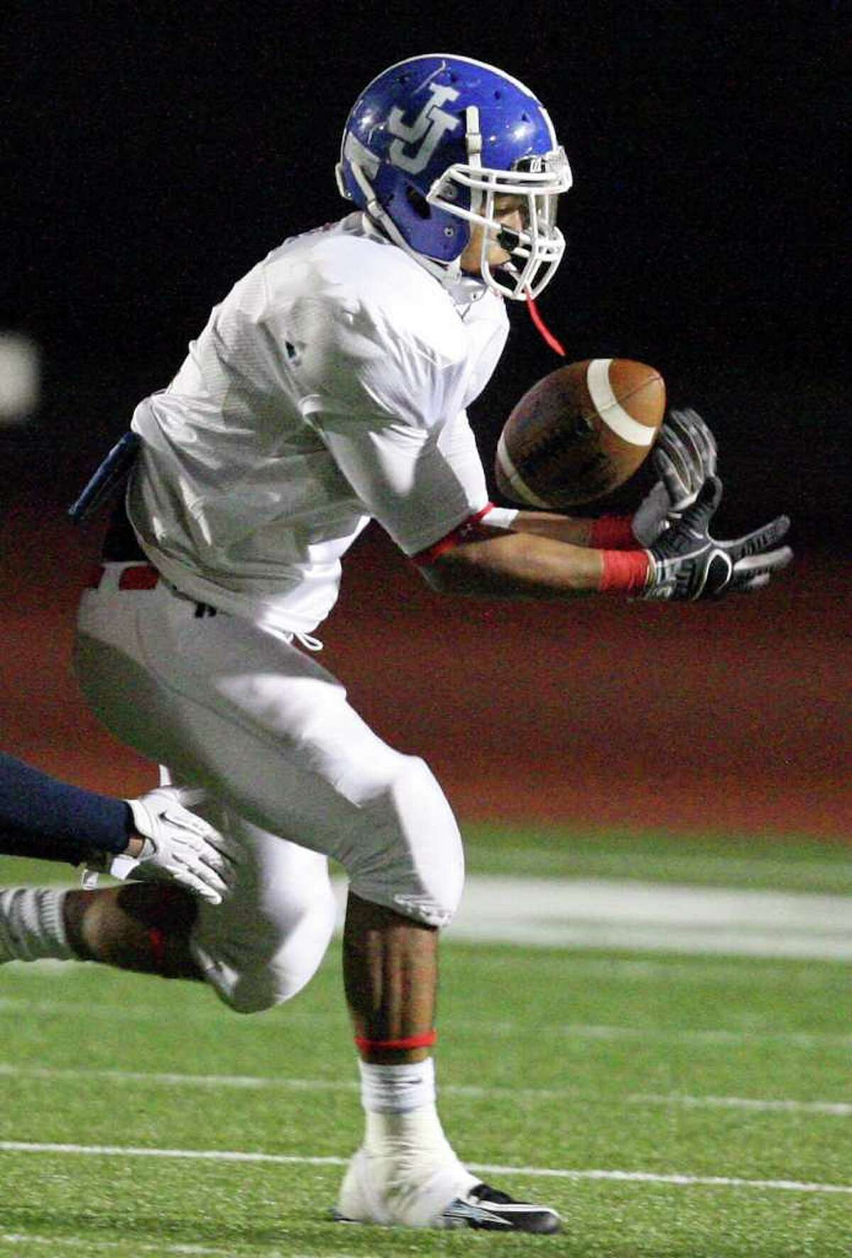 West team's Robert Cevallos drops a pass during second half action against the East team in the 33rd annual Pizza Hut High School All-Star Football Game held Saturday May 21, 2011 at Heroes Stadium. The East team won 15-7.