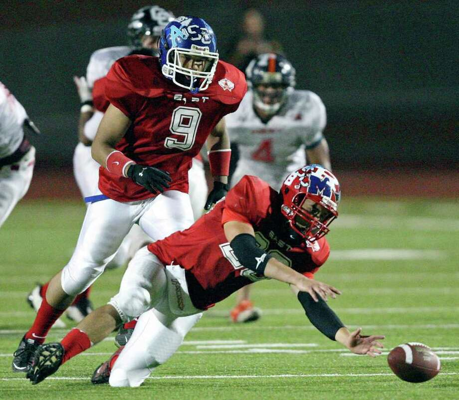 East team's Drake Cannon grabs for a fumble as teammate East team's Vincent Yates Jr. move in during second half action against the West team in the 33rd annual Pizza Hut High School All-Star Football Game held Saturday May 21, 2011 at Heroes Stadium. The East team won 15-7. Photo: EDWARD A. ORNELAS, Edward A. Ornelas/Express-News / SAN ANTONIO EXPRESS-NEWS (NFS)