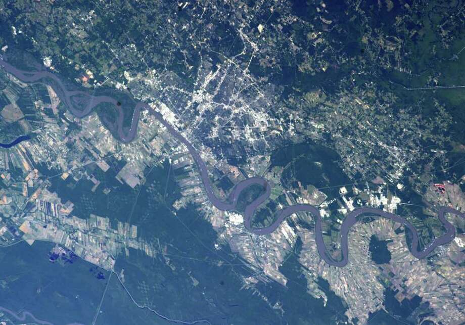 This image provided by NASA shows the flooded Mississippi river at Memphis Tenn., taken by astronaut Ron Garan from the International Space Station, Tuesday May 17, 2011. The opening of the Morganza spillway north of Baton Rouge Saturday May 14, 2011 helped keep ports open and eased pressure on the levees protecting Baton Rouge and New Orleans. (AP Photo/NASA - Ron Garan) Photo: Ron Garan