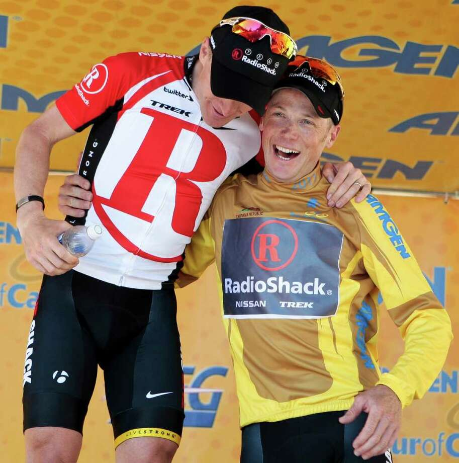 Chris Horner, right, and teammate Levi Leipheimer celebrate together on the podium following Stage 7 of the Tour of California cycling race, Saturday, May 21, 2011, in San Bernardino, Calif. Leipheimer won the stage and Horner retained the yellow jersey.(AP Photo/Bret Hartman) Photo: Bret Hartman