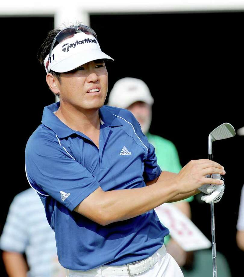 Charlie Wi, of South Korea, watches his tee shot on the 17th hole during the third round of play at the Colonial golf tournament in Fort Worth, Texas, Saturday, May 21, 2011. (AP Photo/Matt Strasen) Photo: Matt Strasen