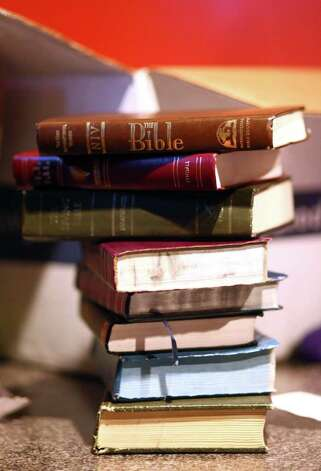 "A stack of Bibles sits on a table during a rapture party on Saturday, May 21, 2011 at Dorky's Arcade in Tacoma, Wash. Groups of local atheists gathered at the arcade in Tacoma on the day that radio minister Harold Camping predicted would be the beginning of rapture. Crew members from the AM radio show ""Ask an Atheist"" were autographing the Bibles as prizes at the event. Photo: JOSHUA TRUJILLO / SEATTLEPI.COM"