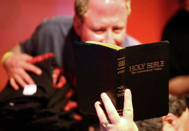 Jerry Schiffelbein, vice president of Seattle Atheists, reads a Bible passage during a rapture party on Saturday, May 21, 2011 at Dorky's Arcade in Tacoma, Wash. Groups of local atheists gathered at the arcade in Tacoma on the day that radio minister Harold Camping predicted would be the beginning of rapture. Photo: JOSHUA TRUJILLO / SEATTLEPI.COM