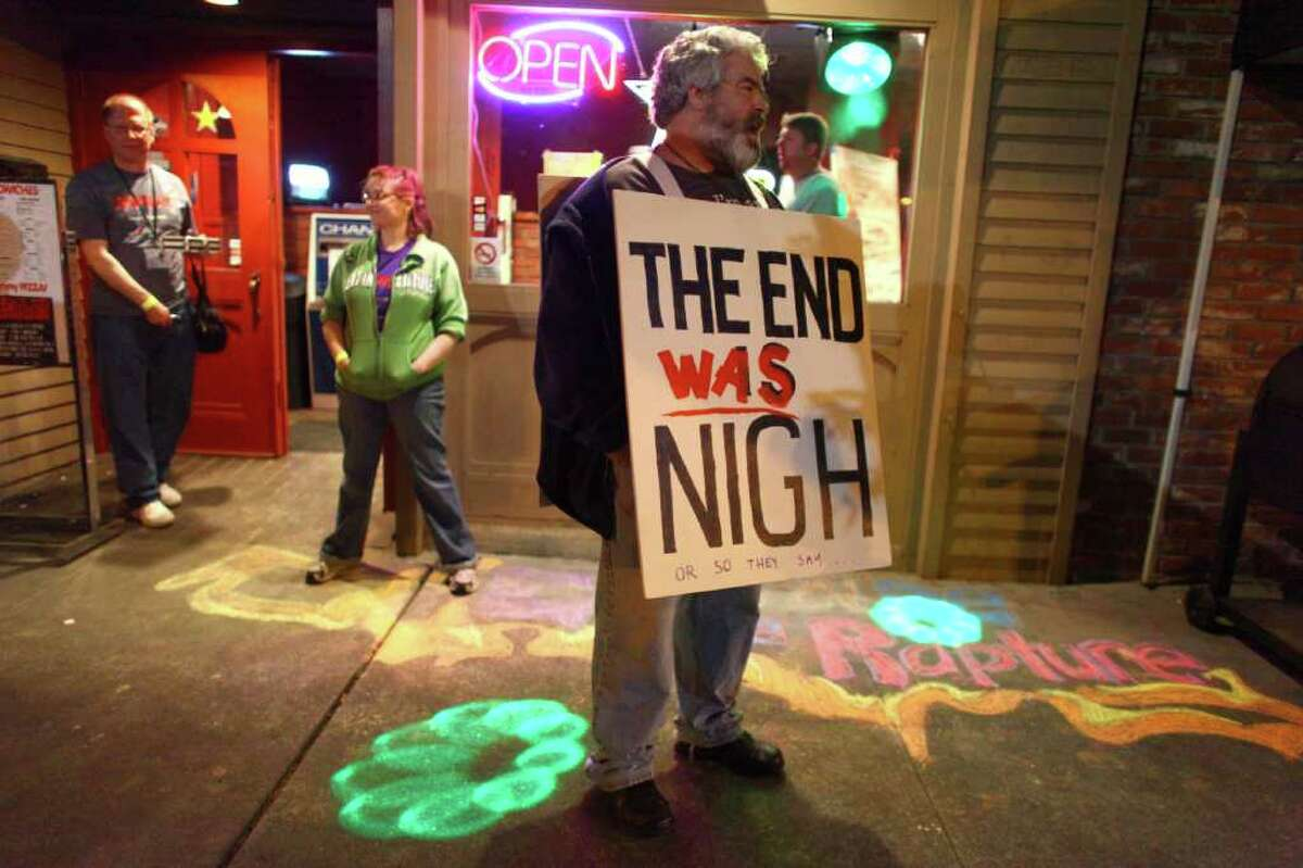 Jim Hoerst of Seattle Aethists stands near the door of a rapture party on Saturday, May 21, 2011 at Dorky's Arcade in Tacoma, Wash. Groups of local atheists gathered at the arcade in Tacoma on the day that radio minister Harold Camping predicted would be the beginning of rapture.