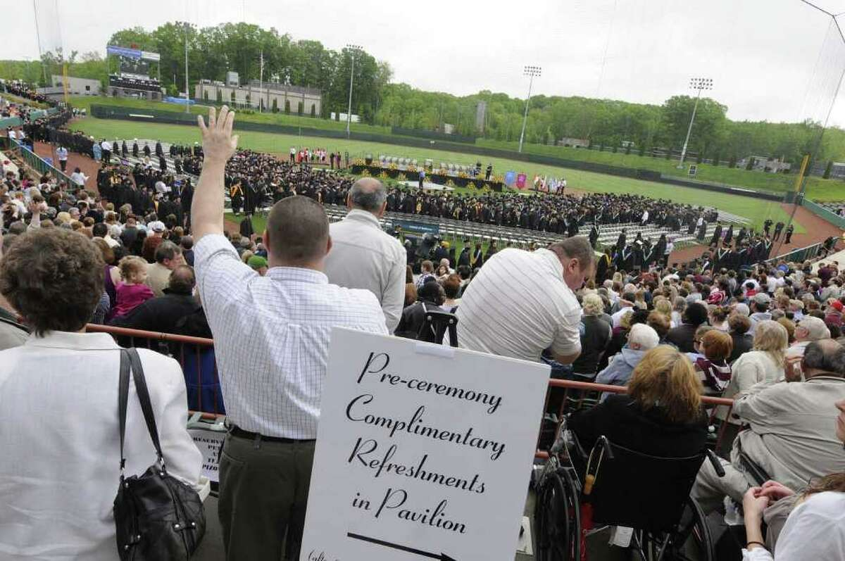 Graduates and well wishers pack the seats and infield during the Hudson Valley Community College Commencement Ceremony at the Joseph L. Bruno stadium in Troy, NY Saturday May 21, 2011.( Michael P. Farrell/Times Union )