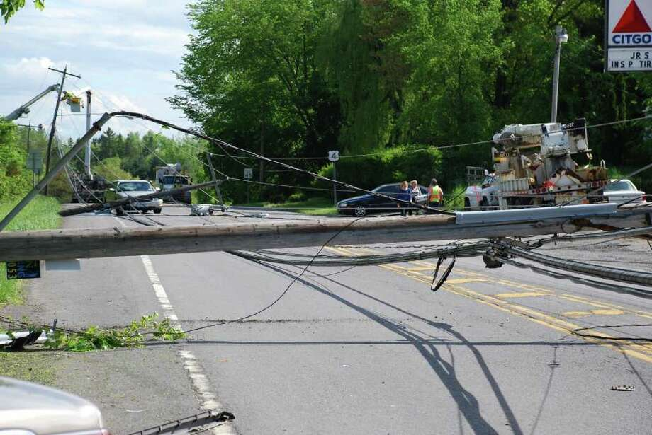 A section of Route 4 in East Greenbush was closed for much of Saturday and into Sunday after a car caused three utility poles to fall into the roadway. Several motorists had to remain in their cars while utility crews removed wires from the vehicles.  (Tom Heffernan) Photo: Picasa