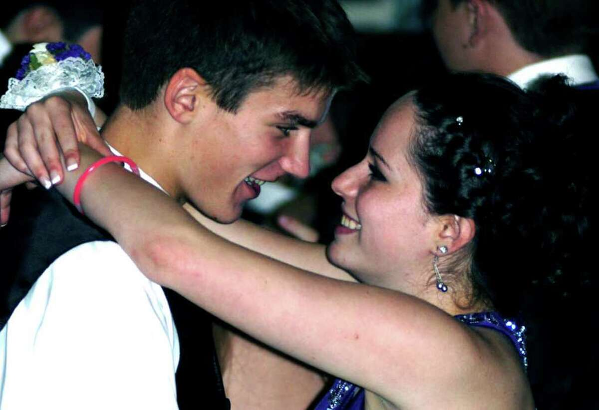 SPECTRUM/Matthew Svinte and Ashlyn Pacific share a special smile as they dance at the New Milford High School senior prom, May 20, 2011 at the Waterview in Monroe.