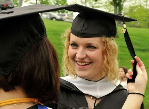 Graduate Paige Meehan, of Newtown, gets a helping hand before commencement ceremonies at Western Connecticut State University, in Danbury, Sunday, May 22, 2011, Photo: Michael Duffy / The News-Times