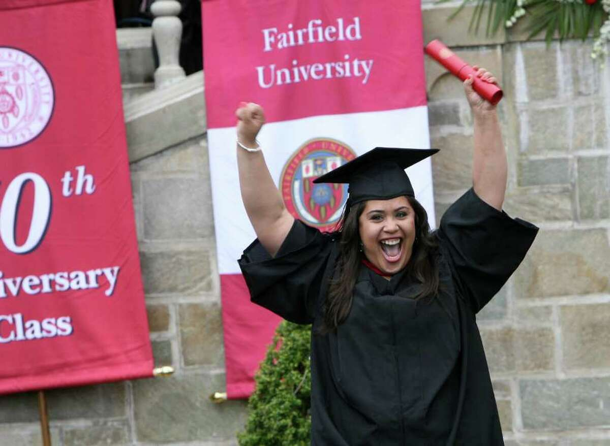 Eveyln Saiter, of Stratford, cheers after receiving her diploma at Fairfield University's Commencement on Sunday, May 22, 2011.