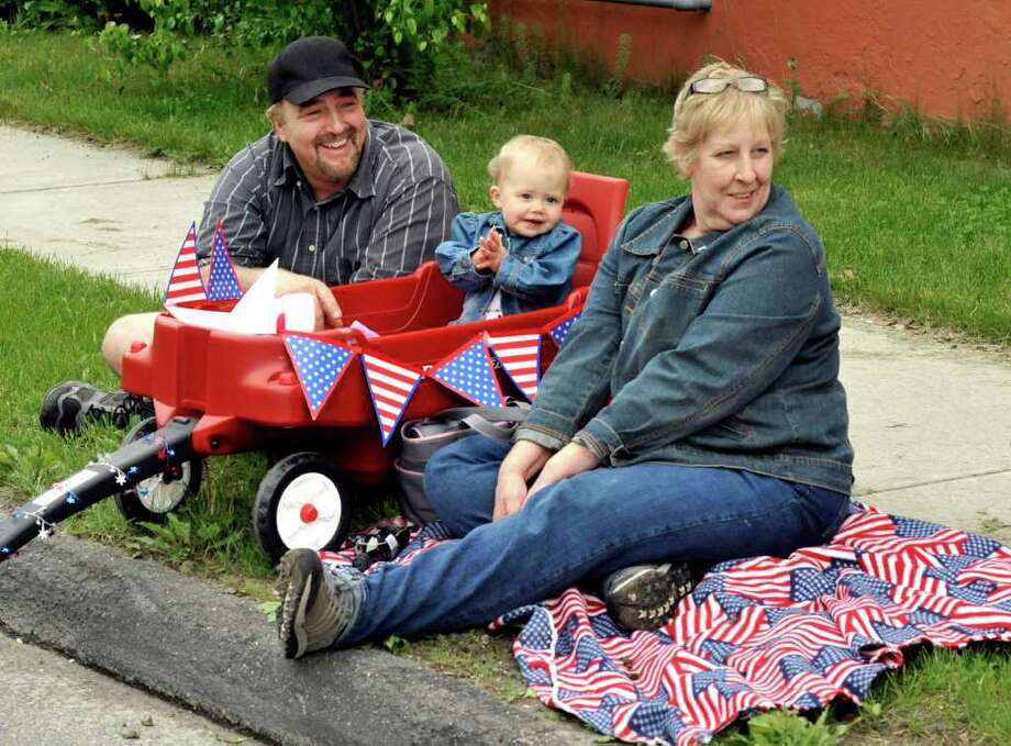 Brian and Rene Gardner, of Brookfield, enjoy Bethel's Memorial Day parade with their 11-month-old granddaughter, Morgan Kotach, of Bethel, Sunday, May 22, 2011. Photo: Michael Duffy / The News-Times