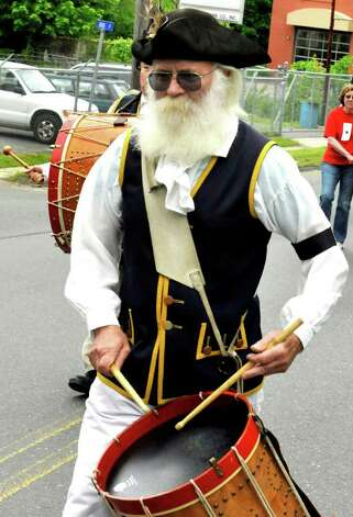 Robert Paradise marches with the Germantown Ancient Fife and Drum Corps in Bethel's Memorial Day parade, Sunday, May 22, 2011. Photo: Michael Duffy / The News-Times